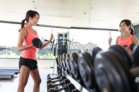 young, woman, weight, training, and, taking - 22700397
