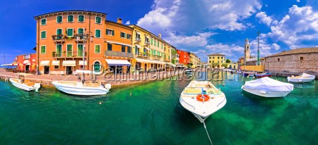 lazise colorful harbor and boats panoramic