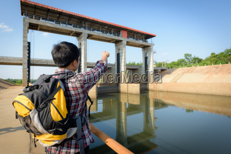 male backpacker tourists pointing to the