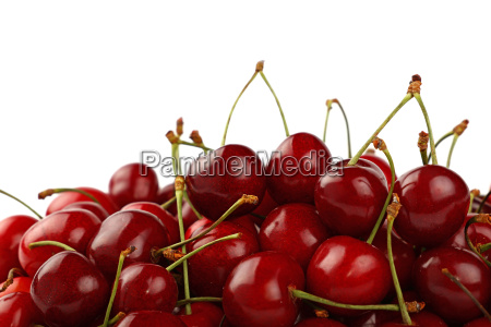 heap of red sweet cherry isolated