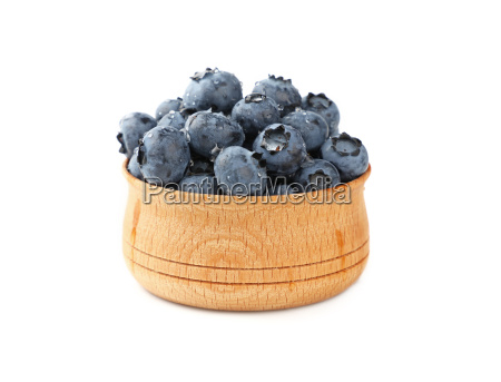 blueberries in wooden bowl close up