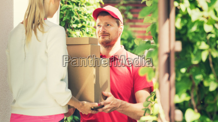 woman accepting a home delivery of