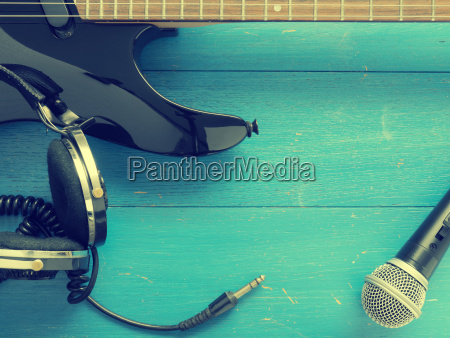 old, headphones, and, guitar, on, wood - 22718125
