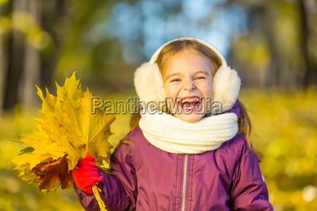 happy, little, girl, in, earflaps, with - 22719027
