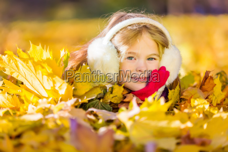 little, girl, in, earflaps, playing, with - 22719039