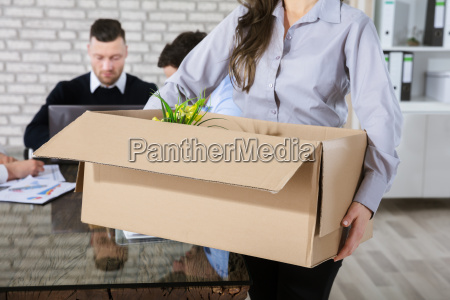 unemployed woman with box