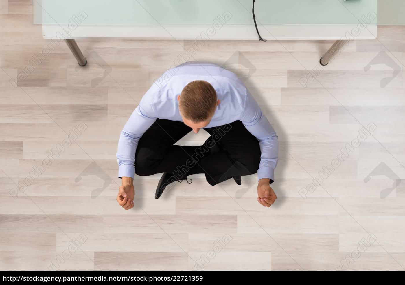 businessman, doing, meditation, in, office - 22721359