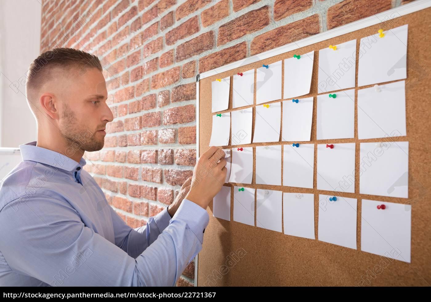 businessman, looking, at, notes - 22721367