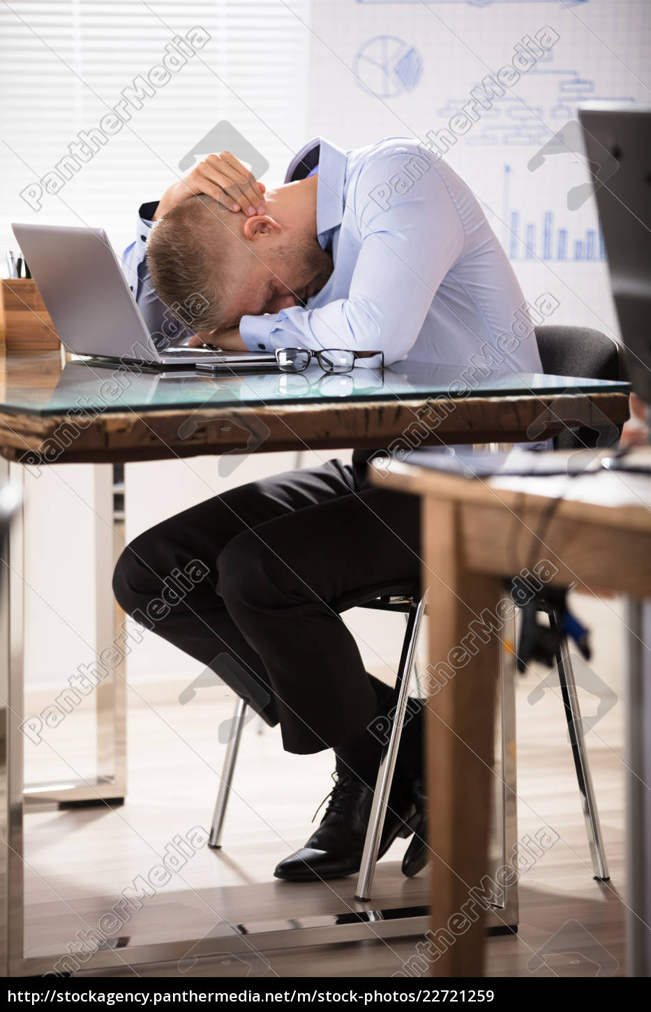 businessman, sleeping, over, the, desk - 22721259