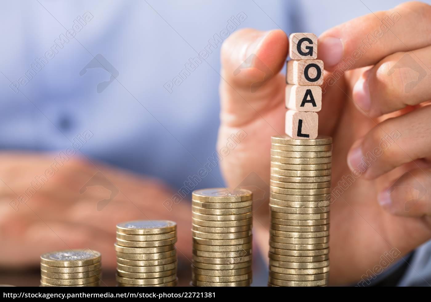 hand, holding, goal, blocks, over, the - 22721381