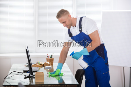 janitor, cleaning, desk, with, cloth, in - 22721389