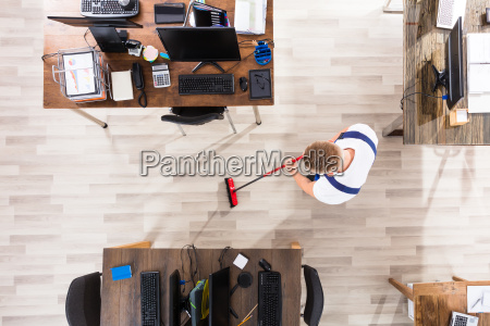 janitor, cleaning, floor, with, broom, in - 22721385
