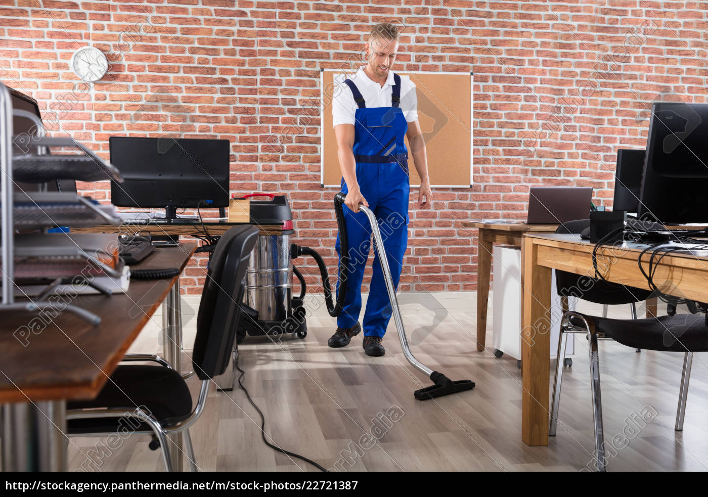 janitor, cleaning, floor, with, vacuum, cleaner - 22721387