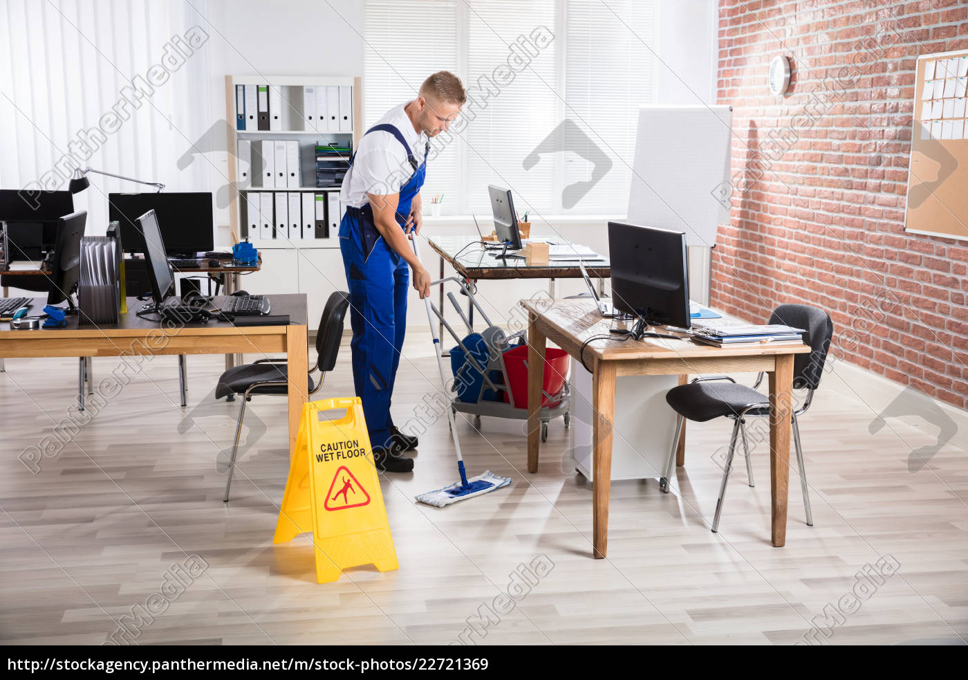 male, janitor, cleaning, floor, with, mop - 22721369