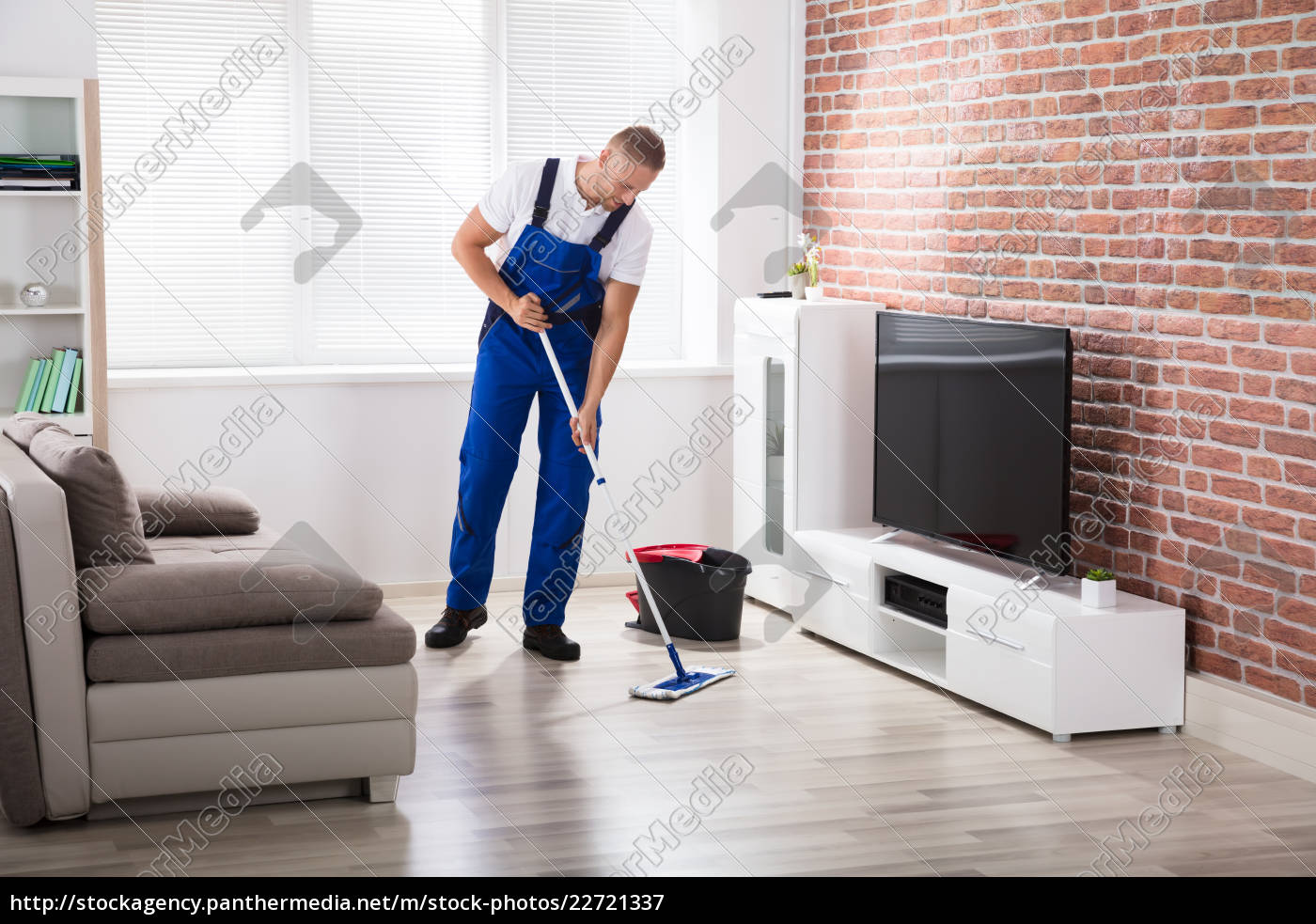 male, janitor, sweeping, floor, at, home - 22721337