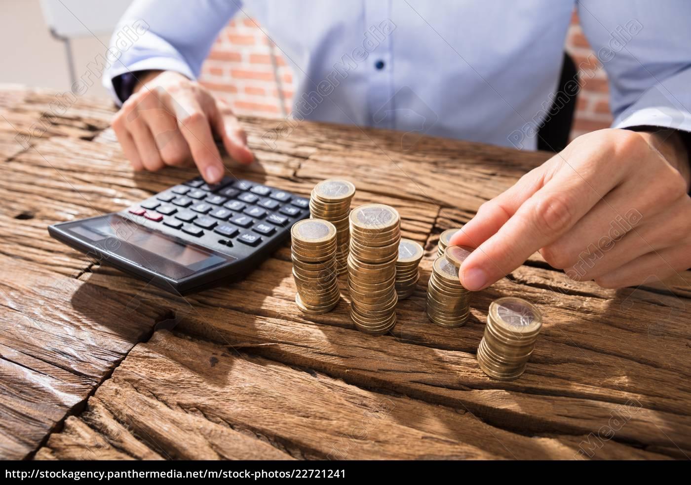 person, calculating, using, calculator - 22721241