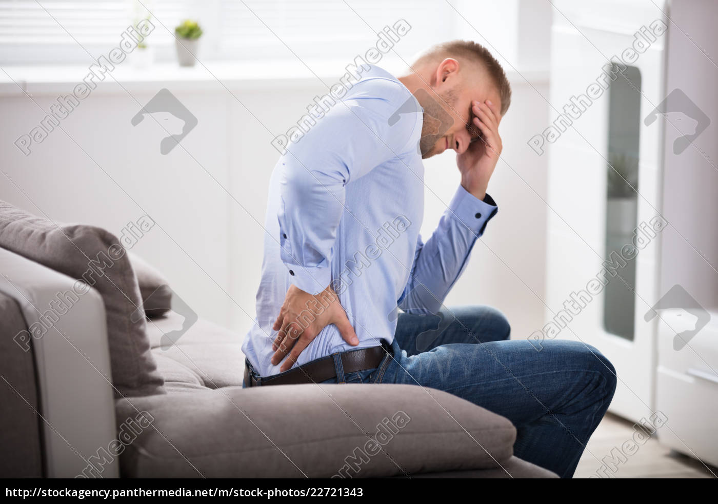young, man, suffering, from, headache - 22721343