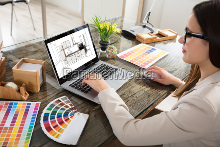 woman selecting color for the kitchen