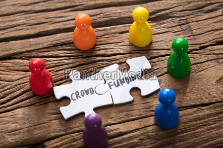 crowd funding jigsaw pieces surrounded by