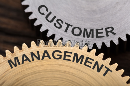 customer management concept on interlocked cogwheels