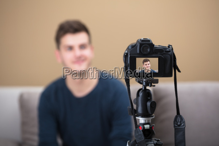 blogger, recording, video, with, camera - 22722929