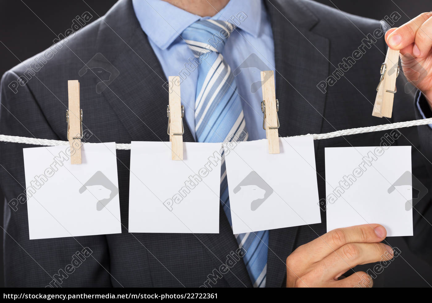 businessman, pinning, blank, paper, on, clothesline - 22722361