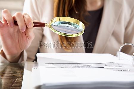 businesswoman, examining, invoices - 22722055