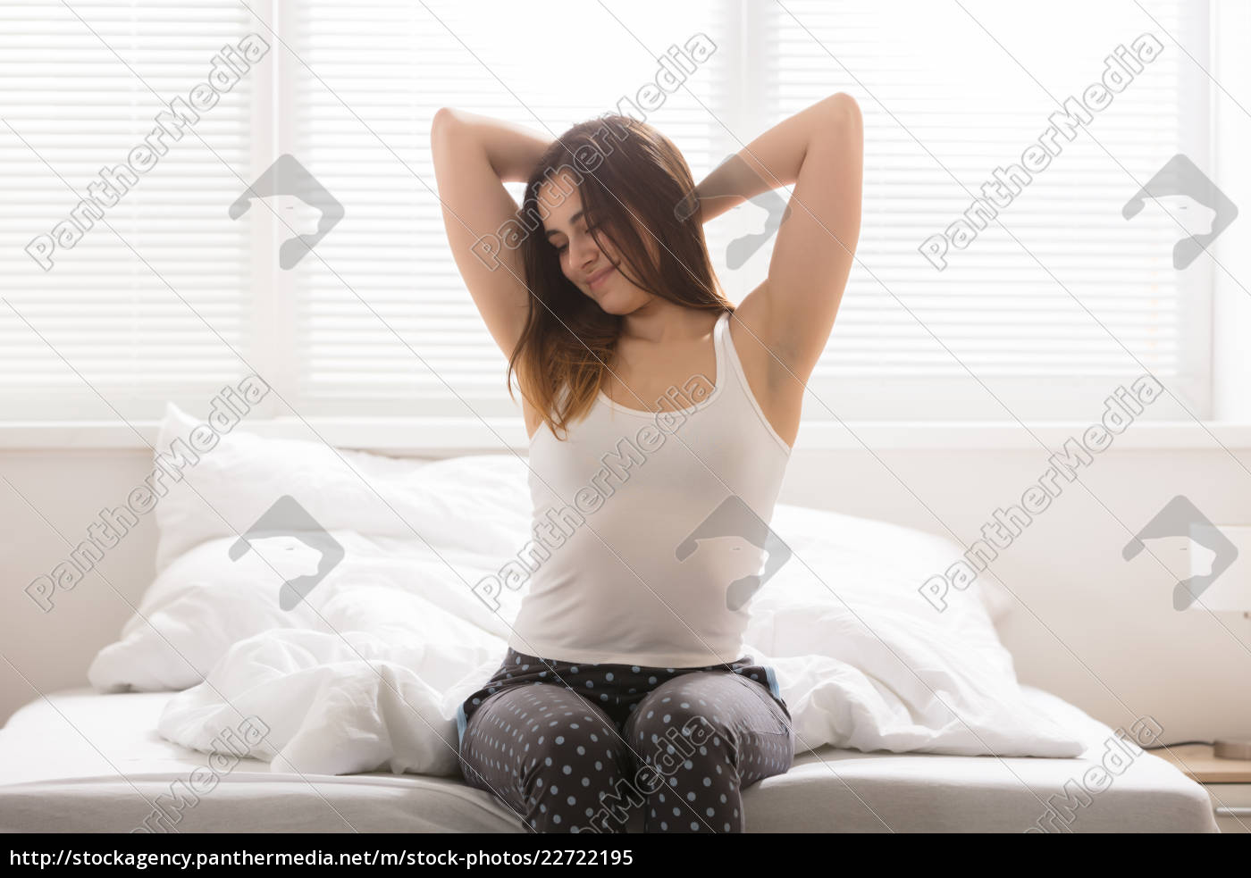 happy, sleepy, woman, on, bed - 22722195