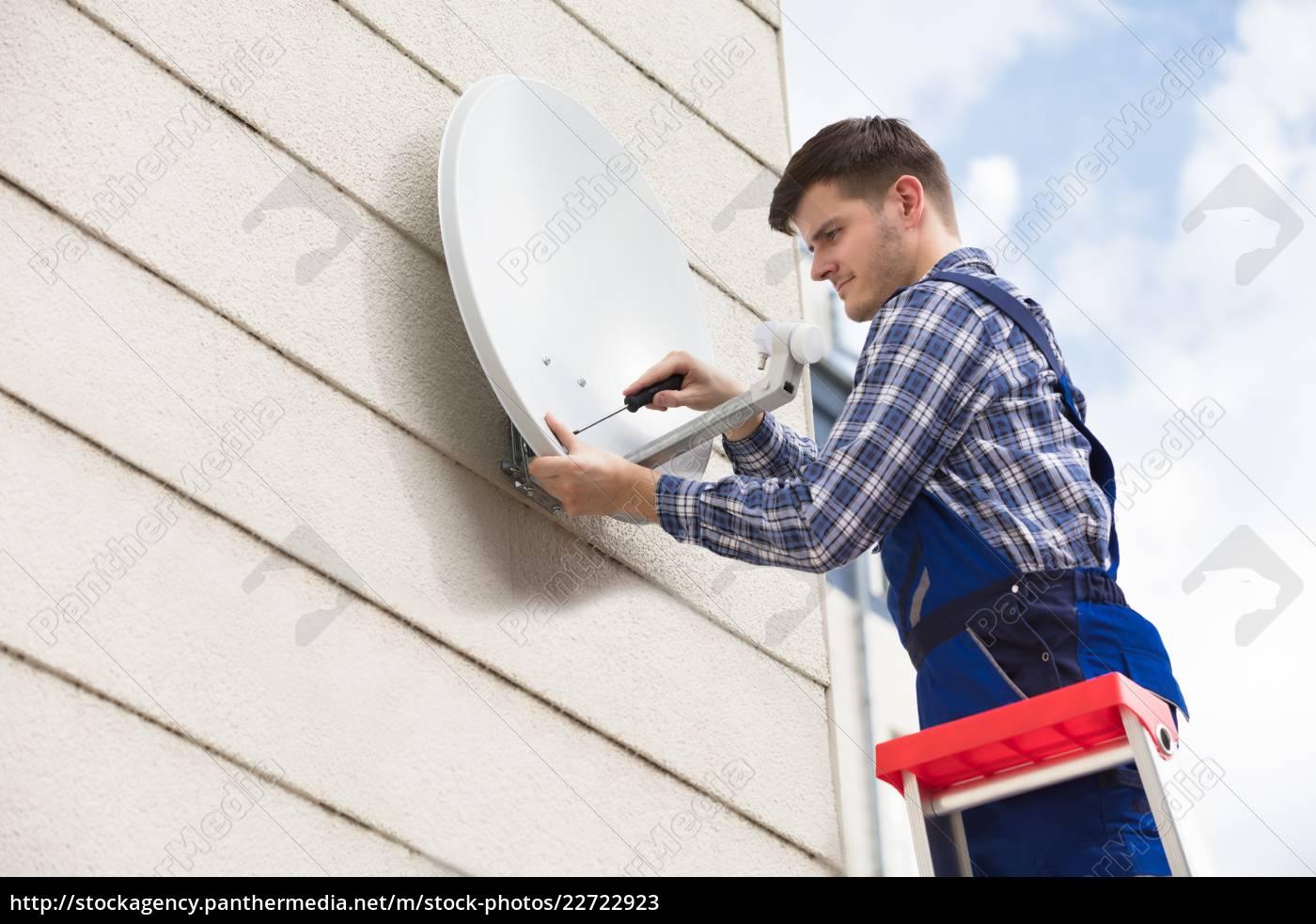 technician, installing, tv, satellite, dish, on - 22722923