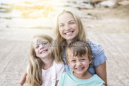 mother with children cuddling on the