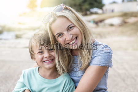 mother and son cuddling on the