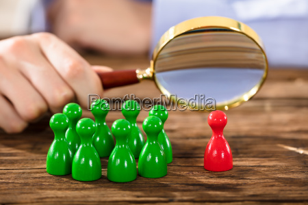 human, hand, examining, red, plastic, figure - 22723009