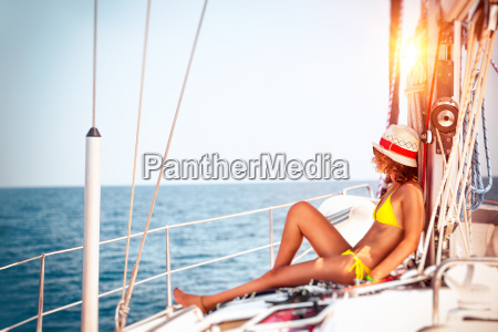 woman, relaxing, on, sailboat - 22723225