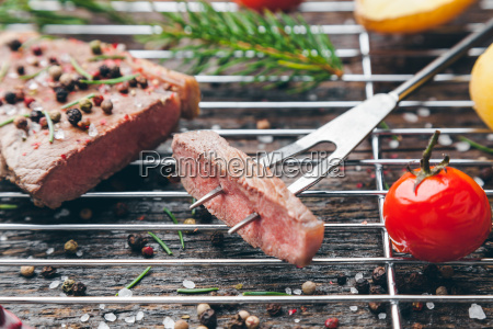 delicious grilled steak with seasoning on