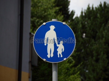 blue pedestrian sign with man and