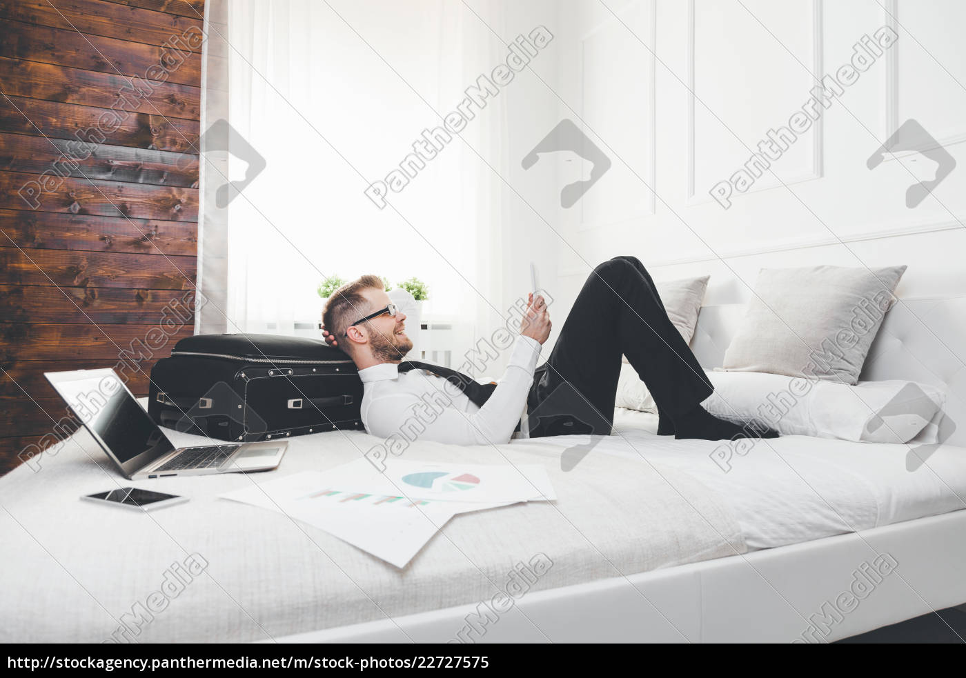 businessman, on, bed, working, with, a - 22727575