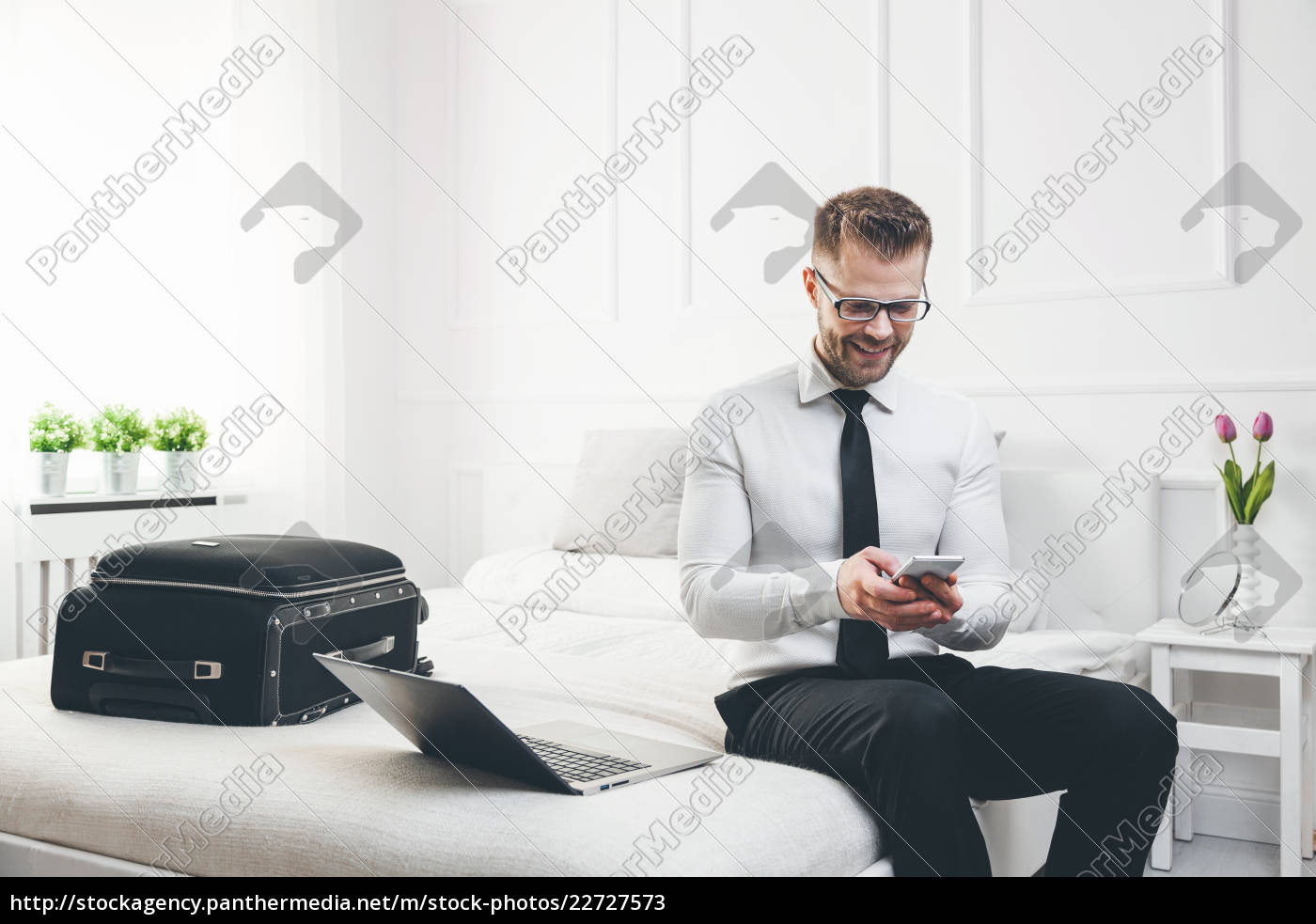businessman, working, from, a, hotel, room - 22727573