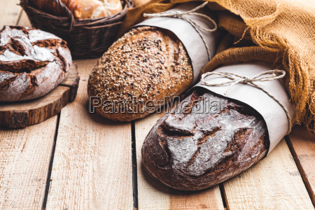 delicious, fresh, bread, on, wooden, background - 22727587