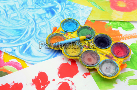 child paints water colours