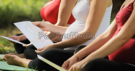 pregnant women in prenatal class with