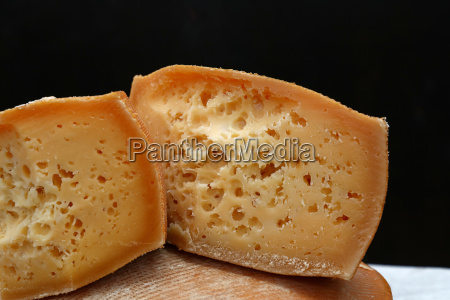 cut block of aged cheese over