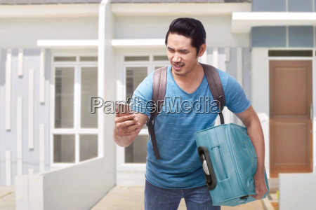 portrait of asian traveler man running