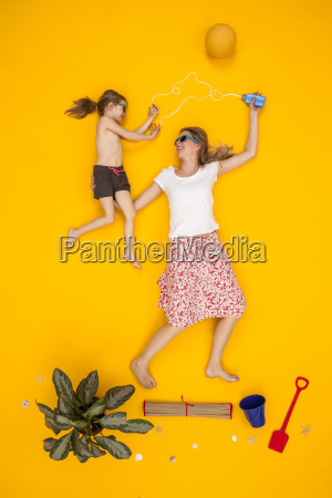 mother and daughter applying suncream at