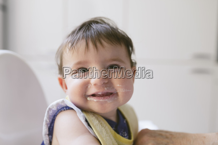 portrait of smiling baby girl after