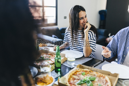 friends having a pizza at home