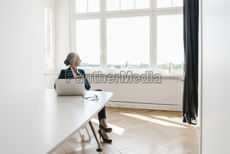 businesswoman working on laptop in office