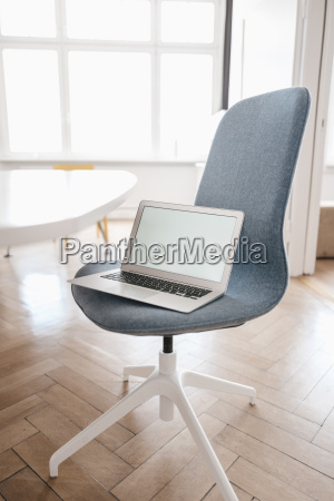 laptop on chair in office