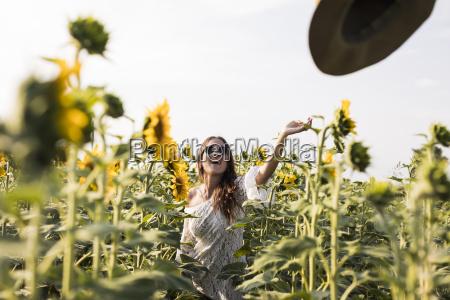 happy woman in a sunflower field