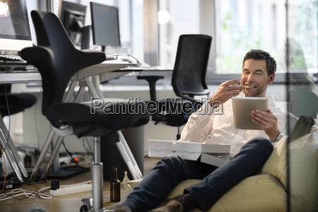 businessman in bean bag in office