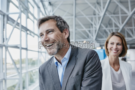 happy businessman and businesswoman at the